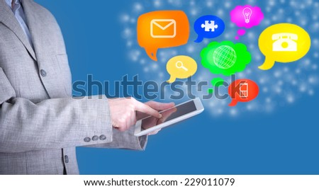 man use tablet pc with colorful application icons
