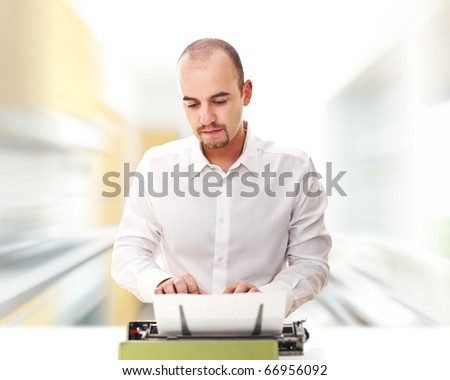 man use typewriter and abstract speed image background - stock photo