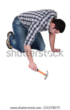 Man using a hammer - stock photo