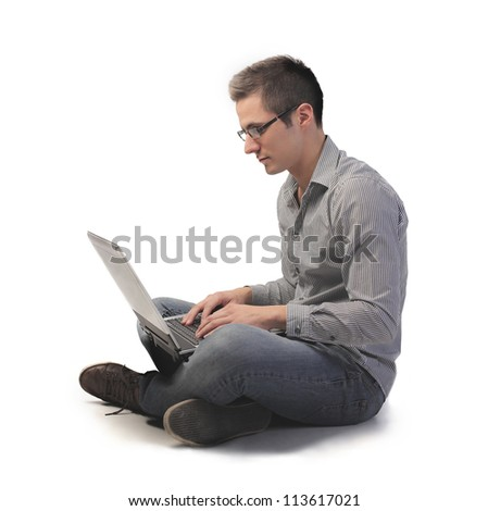 Man using a laptop computer - stock photo
