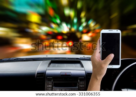 Man using a mobile phone while driving , very danger. - stock photo