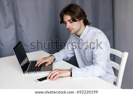 man using a smartphone.  A young freelancer