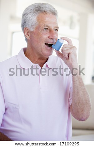Man Using An Inhaler
