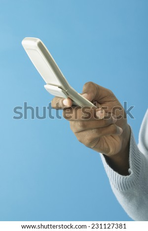 Man Using Cell Phone - stock photo