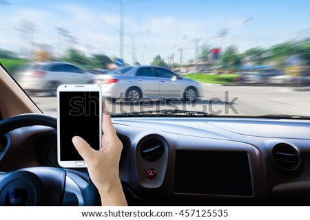 Man using cell phones while driving,  motion image of accident will happen as background.