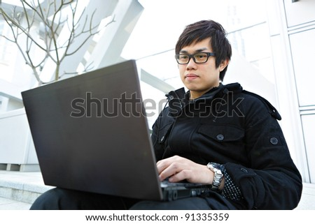 man using computer outdoor - stock photo
