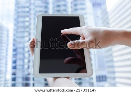 Man using digital tablet computer - stock photo