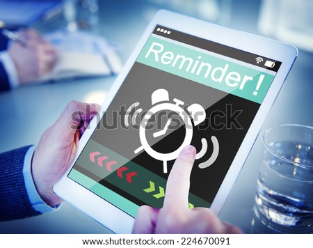 Man Using Digital Tablet with Reminder - stock photo