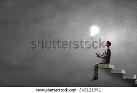 Man using his mobile phone - stock photo