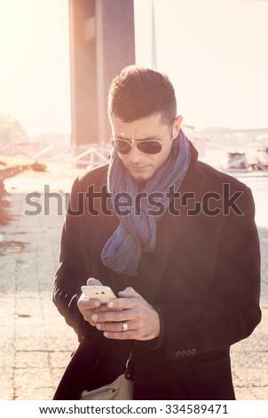 Man using his smart phone outdoor,selective focus  - stock photo