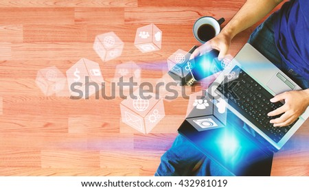 Man using laptop and hand touch screen smart phone with social icons, Social media concept. - stock photo