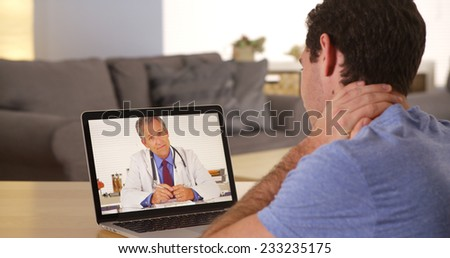 Man using laptop to talk to doctor - stock photo