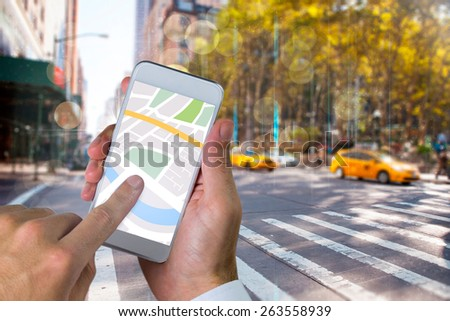 Man using map app on phone against blurry new york street - stock photo