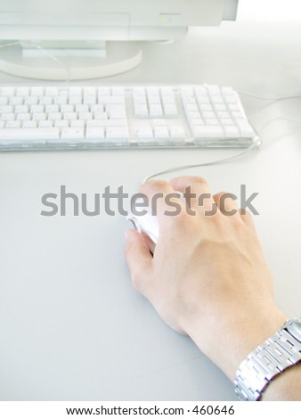 Man using mouse on computer - stock photo