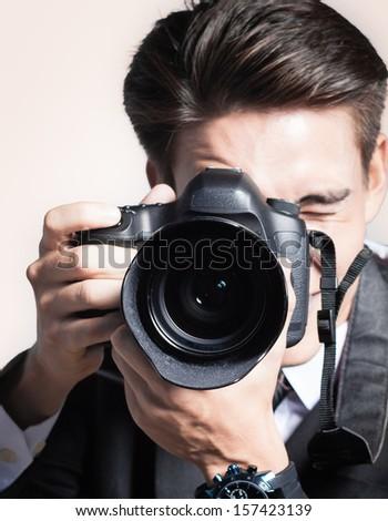 Man using professional camera - stock photo