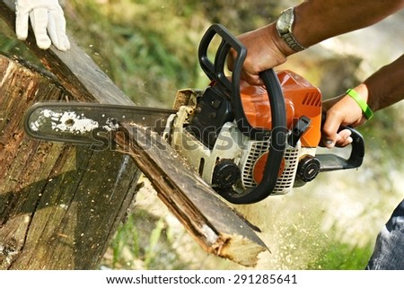 man using saw - stock photo