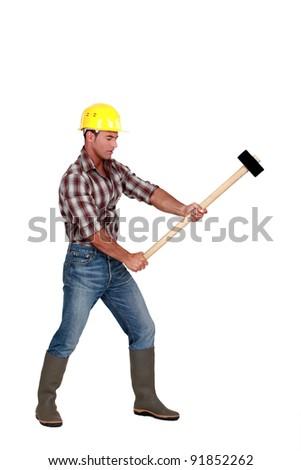 Man using sledge-hammer - stock photo