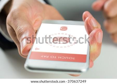 Man using smartphone against web - stock photo