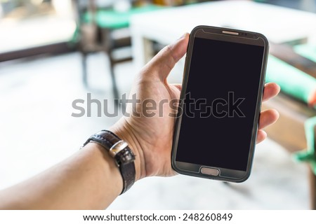 Man using smartphone, close-up - stock photo