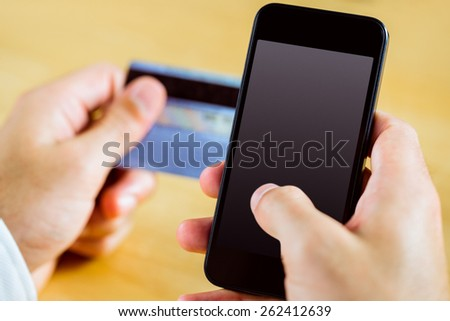 Man using smartphone for online shopping in close up - stock photo