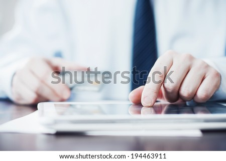 Man Using Tablet and Holding Credit Card. - stock photo