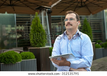 Man using tablet computer with high speed internet outdoors