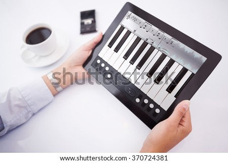 Man using tablet pc against music app