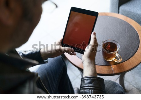 man using tablet pc in cafe - stock photo