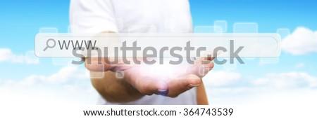 Man using tactile interface web address bar - stock photo