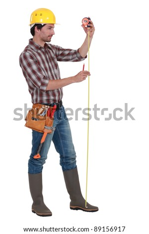 Man using tape measure