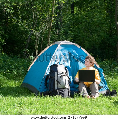 Man using technology while camping - stock photo
