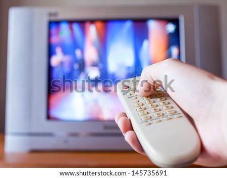 Man using Tv Remote Control - stock photo