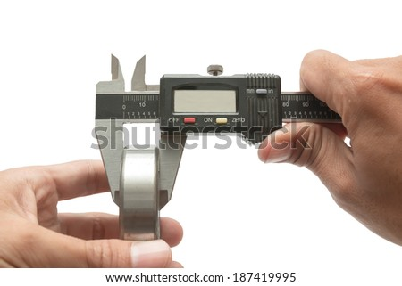 Man using vernier caliper Measurements of the Bearing, on white background - stock photo