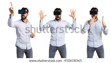 Man using VR glasses doing surprise gesture