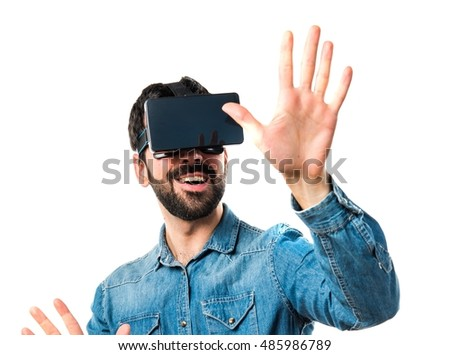 Man using VR glasses touching on transparent screen