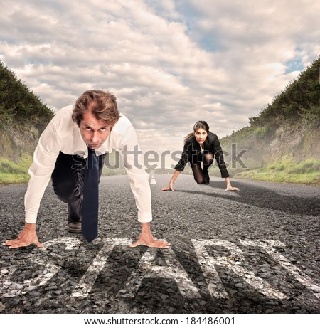 man versus woman on a road ready to run - stock photo