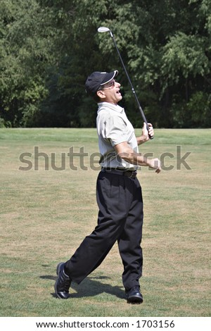 Man very happy with his golf drive. - stock photo