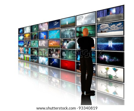 Man viewing video displays on white - stock photo