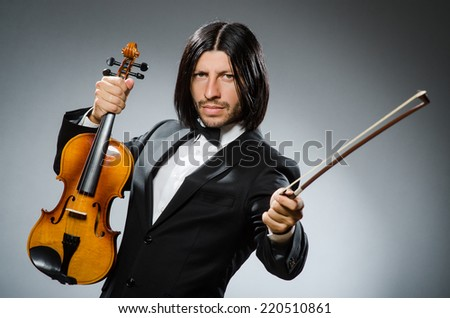 Man violin player in musican concept - stock photo