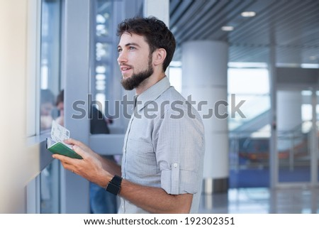 man waiting for his flight in the international airport - stock photo
