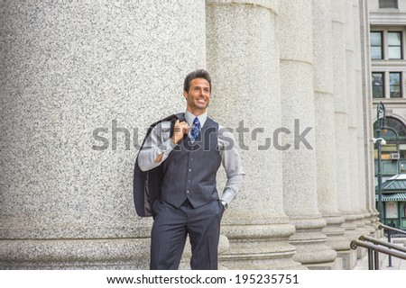 Man Waiting Outside. Dressing in light gray shirt, dark blue vest, necktie, jacket taken off on shoulder, a  handsome, middle age businessman is standing by columns outside,  smiling, looking up.  - stock photo