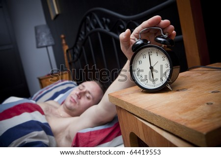 Man waking up in the morning - stock photo