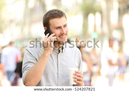 Man walking and talking on the mobile phone in the street