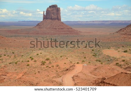 Man Walking at Monument Valley Tribal Park Trail in Utah, USA