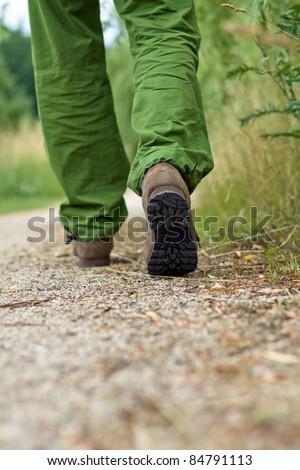 Man walking in park, exercise outdoors - stock photo