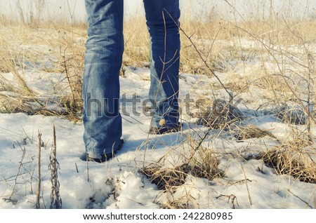 Man walking in the snow  - stock photo