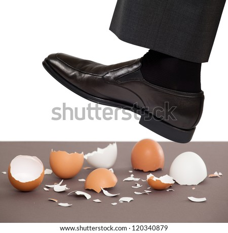 Man walking on egg shells - stock photo
