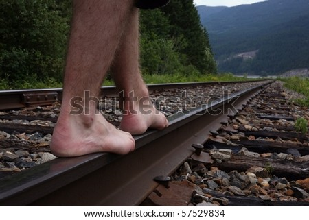 Man walking on railway track