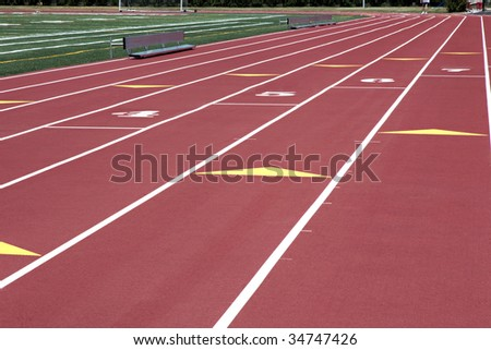 Man walking on red numbered running track