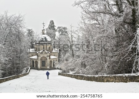 Man walking on the path in a snowy afternoon, Sacred Mount of Varese - stock photo